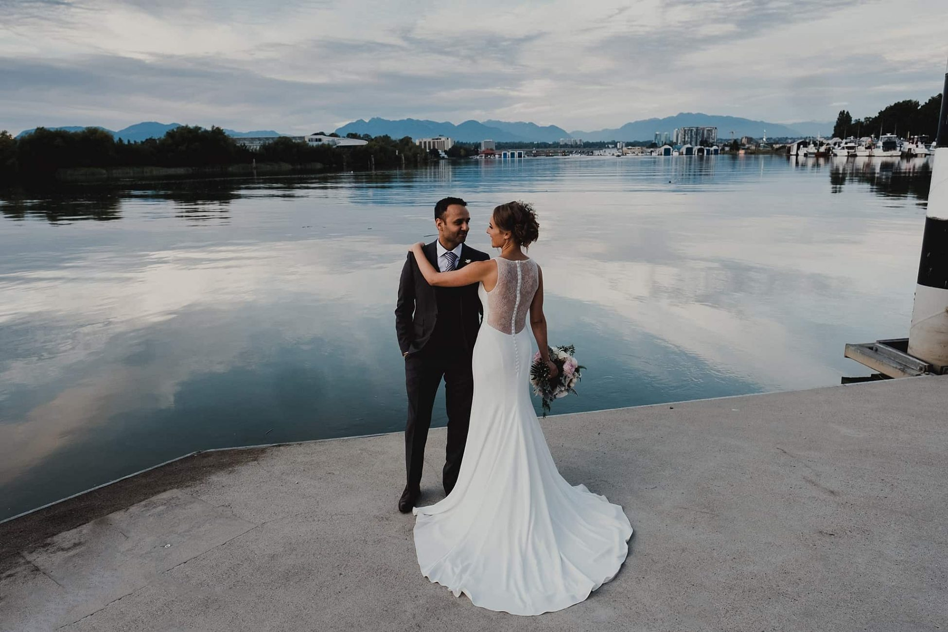 Couple pose at bank of Fraser River