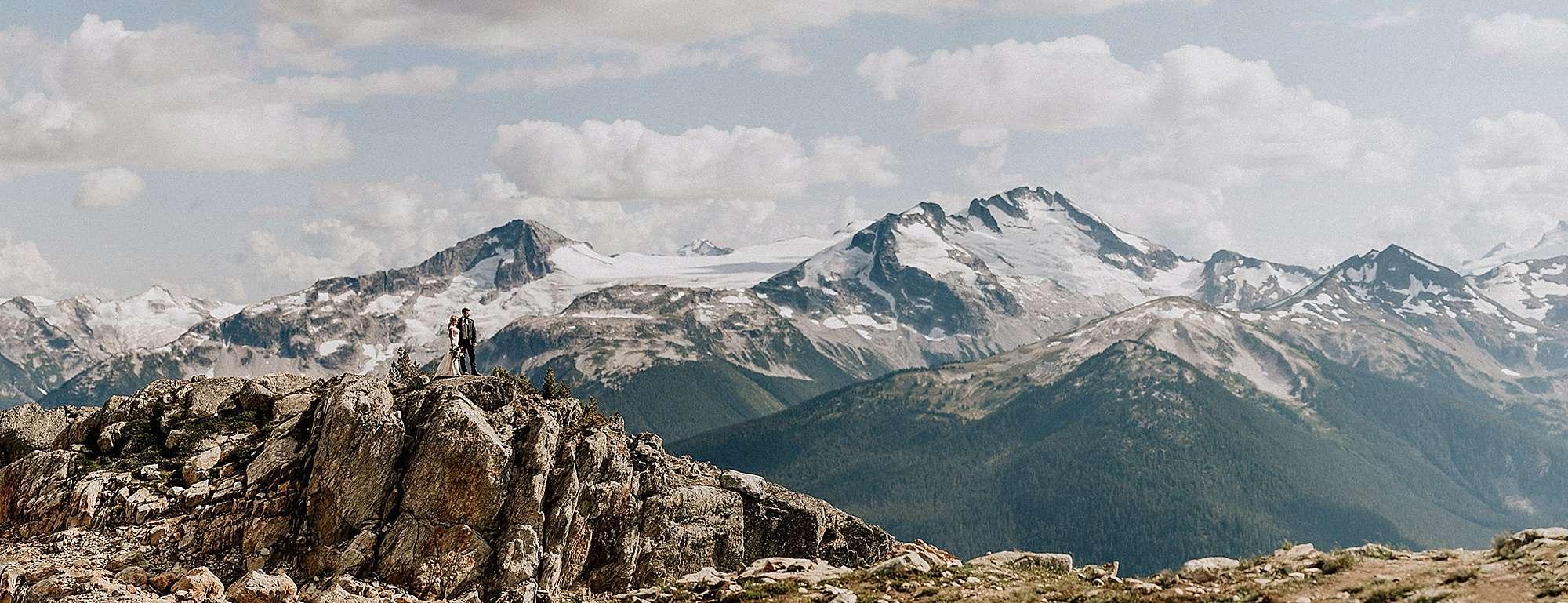 wedding couple on mountain top whistler bc